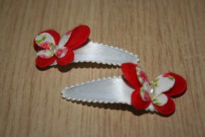 Haarclipje met kniphoesje vlinder wit/rood