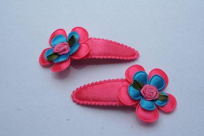Haarclipje met kniphoesje bloem neonroze/neonblauw