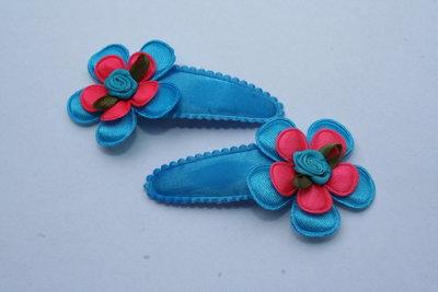 Haarclipje met kniphoesje bloem neonblauw/neonroze