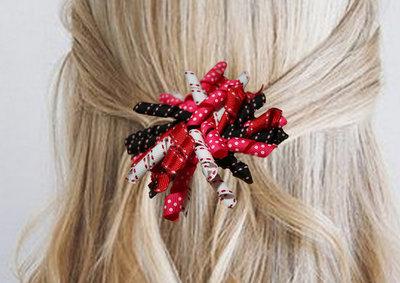 Krullenclip fuchsia/rood/wit/zwart